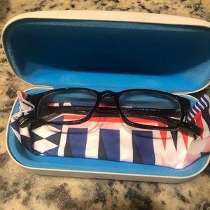 Warby Parker black glasses.